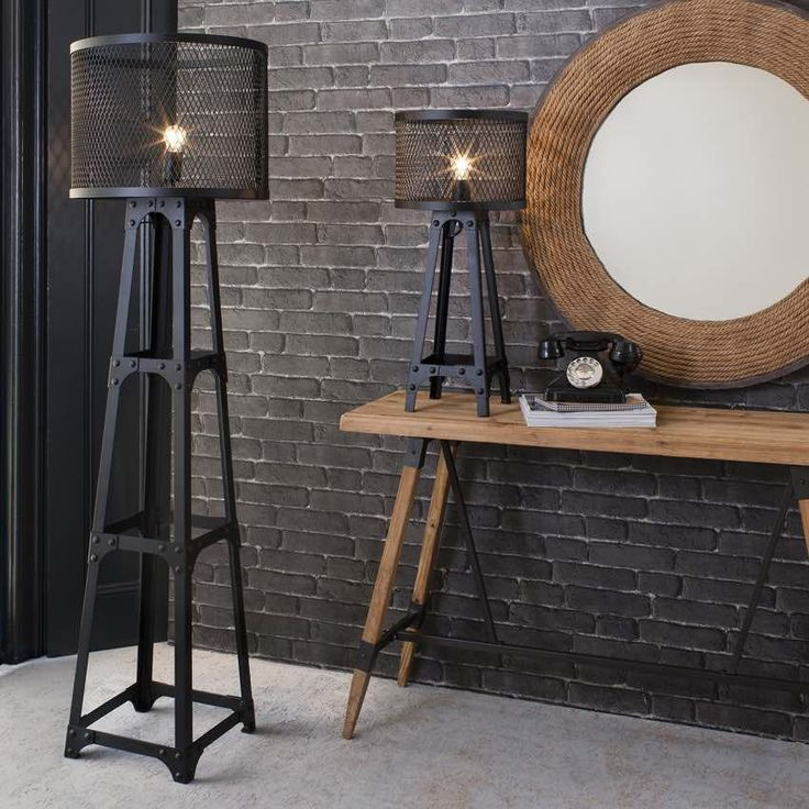 Add a touch of urban chic to your room with our Industrial Tower Floor Lamp by Modish Living.