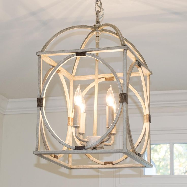 "Circle Lattice Hanging Lantern A wood look finish, geometric shapes, and simplified design make this hanging metal lantern a stylish choice. This 4 light lantern comes in Light Oak or dark Bronze ""wood"" finish with aged gold banding."