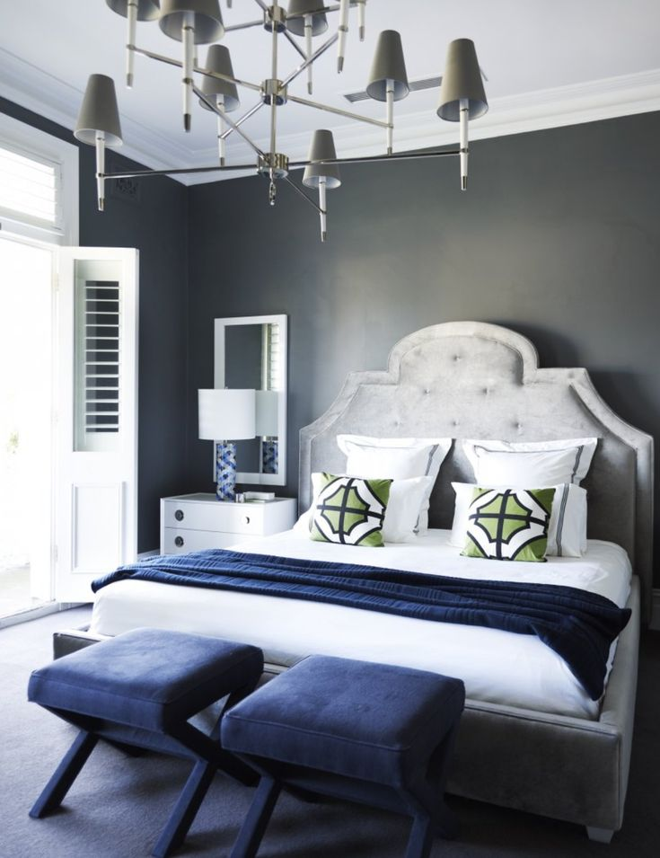 Flip flop walls and headboard-light grey paint with darker grey headboard. White and navy bedding makes for a crisp and clean look