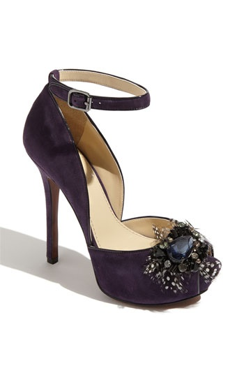 Unique & stylish jewel adorned vintage pump with feather accents!
