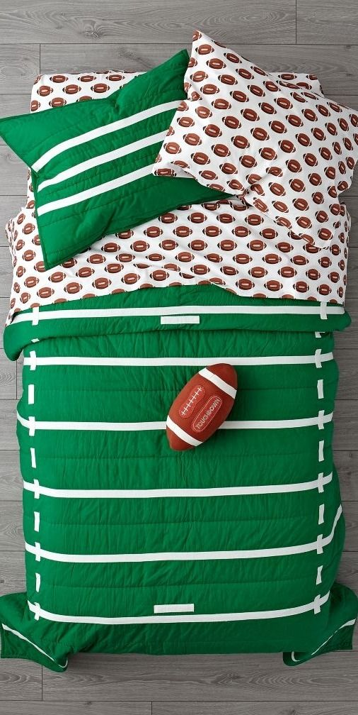 Shop Nod Football Bedding.  Our Nod Football Bedding is so great, it's ready to go pro.  Made from comfy 100% cotton, the quilt is uniquely designed to resemble a green football field.  And the printed sheet set is made from 100% organic cotton.