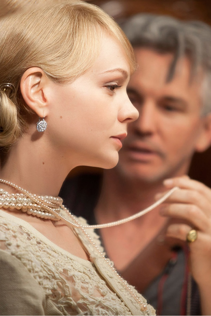 Carey Mulligan in Tiffany jewels with director Baz Luhrmann on the set of Warner Bros. Pictures' and Village Roadshow Pictures' drama The Great Gatsby, a Warner Bros. Pictures release. Photo by Matt Hart.