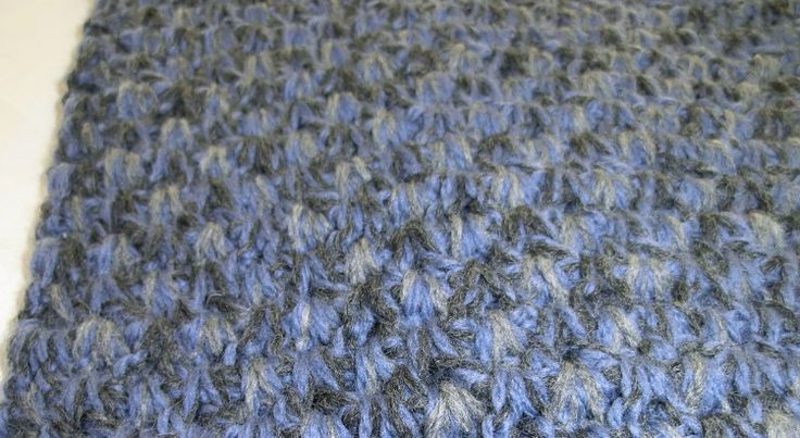 "Halsduk virkad med fyra trådar i ""till min man""-mönster. Scarf crocheted with four threads in ""to my husband""-stitch."
