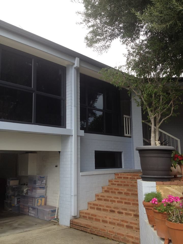 Anthracite window installed to the front elevation of a home.