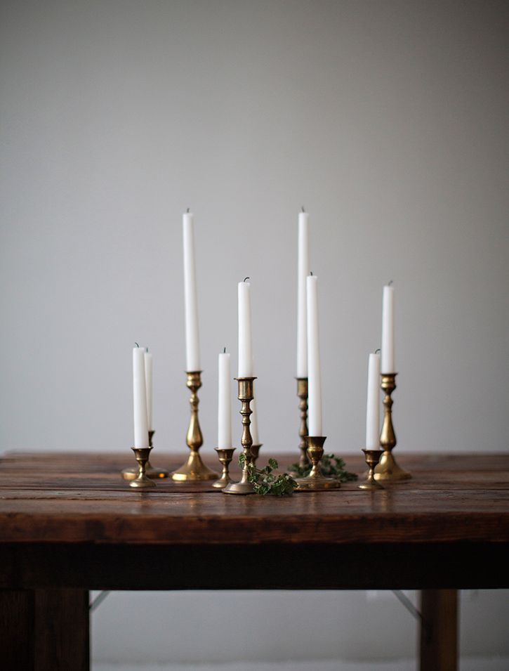 So chic Flickering candlelight makes an outdoor dinner special. I have a very large collection of gorgeous brass candlesticks! www.decorforweddings.com