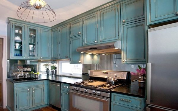 HGTVs Kitchen Cousins did this kitchen and I am in love with it! I absolutely love the colored antique cabinets all with different pulls. The mirrored back splash and the mix of old looking paint and new stainless steal.  This kitchen is the size of a postage stamp, but it is incredibly beautiful!