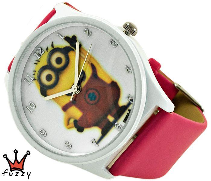 Ρολόι Minions, σε φούξια και λευκό με παραστάσεις minions στο εσωτερικό του. Πλαστικό λουράκι σε φούξια χρώμα. Διάμετρος καντράν 40 mm.