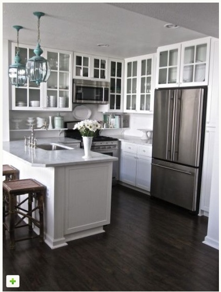 10 Ways to Make a Small Kitchen Feel Bigger  Does your kitchen draw a crowd or crowd you in? Here's how to make sure your compact kitchen leaves room to breathe