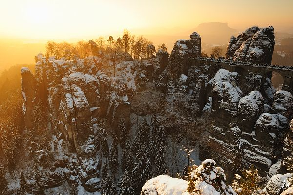 Saxon Switzerland is a mountainous climbing area and national park around the Elbe valley south-east of Dresden in Saxony, Germany. Winter Sunrise by Stefan Mendelsohn.