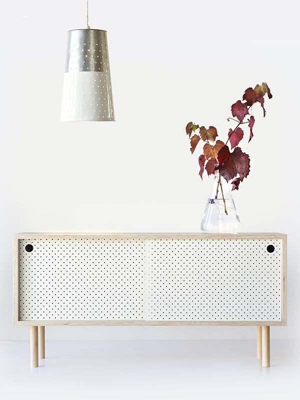 Gorgeous sideboard with white pegboard-like doors.