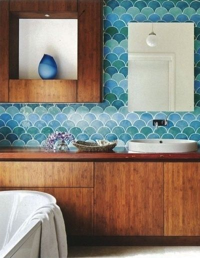 This Australian bathroom from Camilla Molders Designcombines tile and wood to nice effect.