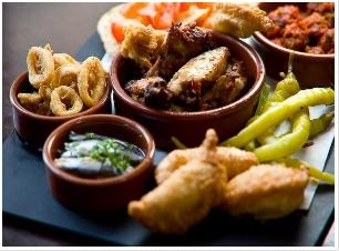 Tapas Board: Albondigas, tomato bread, chilli and lime chicken wings, olive and oregano empanadas, paprika baby squid, white anchovies and pickled green chillies @ The Living Room