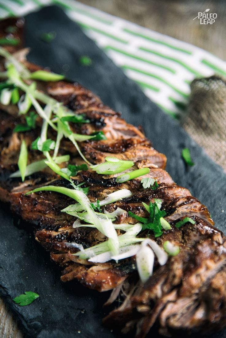 A seasoned pork tenderloin cooked low and slow, then basted in a sweet and spicy garlic-ginger sauce.