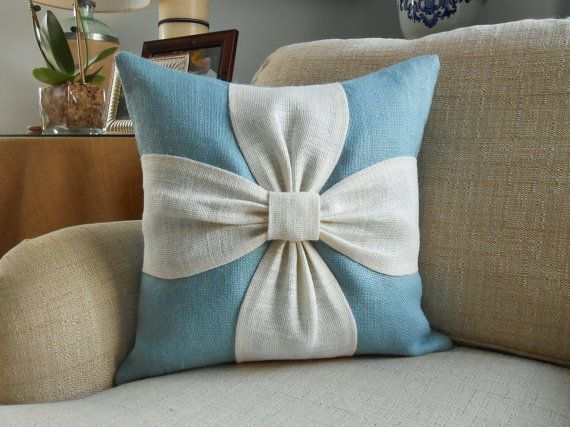 A soothing color palette of aqua and off white burlap are combined to make this beautiful bow pillow cover. The background and back side of this cover are made with an aqua/blue sultana burlap. The bow portion is made with off white sultana burlap or it can be made with natural burlap as shown in the last picture. The details: - Listing is for ONE pillow cover - Envelope closure - Size approximately 17 x 17 made to fit an 18 x 18 pillow insert - Spot clean - Pillow insert *not included*...