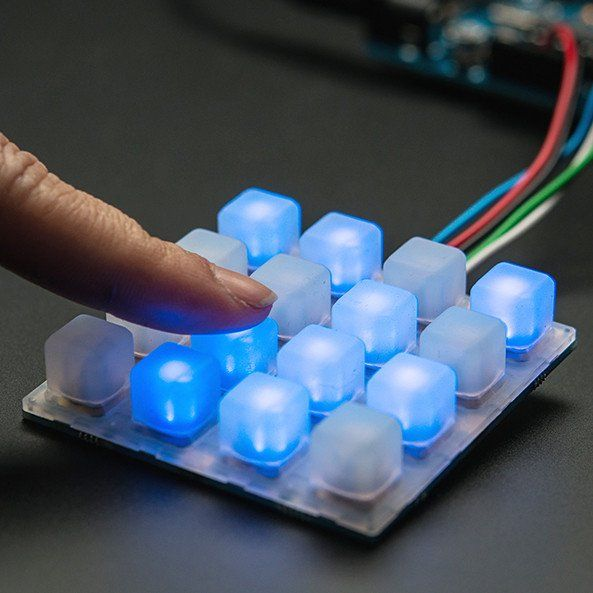 Adafruit Trellis Monochrome Driver PCB for 4x4 Keypad & 3mm LEDs - Trellis is an open source backlight keypad driver system. It is easy to use, works with any 3mm LEDs and eight tiles can be tiled together on a shared I2C bus. Each Trellis PCB has 4x4 pads and 4x4 matching spots for 3mm LEDs.