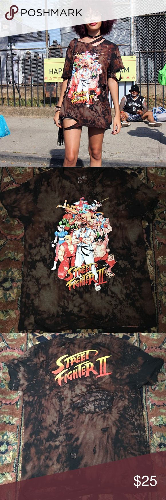 Street Fighters 2 distressed tee✌ This is one of a kind and handmade. I bleached and ripped the T-shirt my self. The are multiple tips (little and big). This gives you that NYC street hip look❤️. This is a large tshirt and can be wore by itself with short or paired with jeans. The material is comfortable and soft. Make sure to wash in cold water ! 21men Tops Tees - Short Sleeve