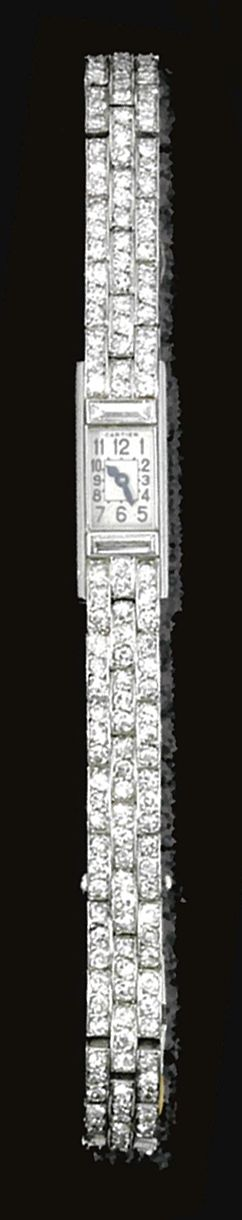 DIAMOND WRISTWATCH, CARTIER, CIRCA 1920.  The rectangular dial, applied with Arabic numerals, bordered by baguette diamonds, the bracelet of brick link design set with single-cut stones, to a deployante buckle, mounted in platinum, circumference approximately 160mm, dial signed Cartier, buckle numbered, French assay marks.