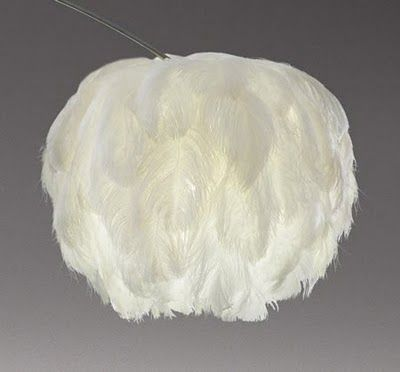 Decorating with Feathers! - Design Dazzle Maybe this would be doable with a ricepaper Ikea lamp, feather and glue?