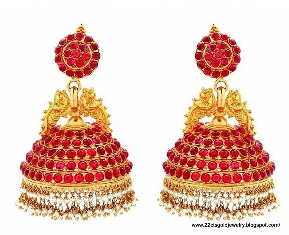 They're called Jumka. Indian jewelry is famous the world over for its beautiful designs.  http://www.nytimes.com/2012/05/16/fashion/in-india-jewelers-and-stars-align.html?pagewanted=all