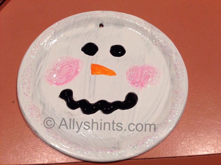 Canning lid jar painted like a snowman face! :) perfect fun ornament