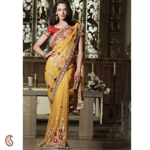 Amber Full Net handwork Sari -- Divine gold and red zari thread with stone and sequined work and buttis across the sari with a bold circular embroidered patchwork lace with contrasting Blouse make it a must this festive season $256