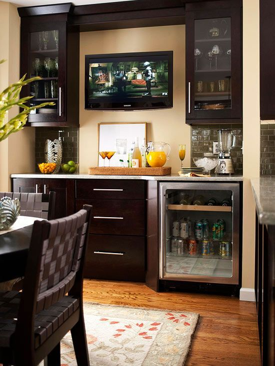 Something similar to what we plan minus the fridge... Alcove for the dining room. Dry bar / sideboard storage.