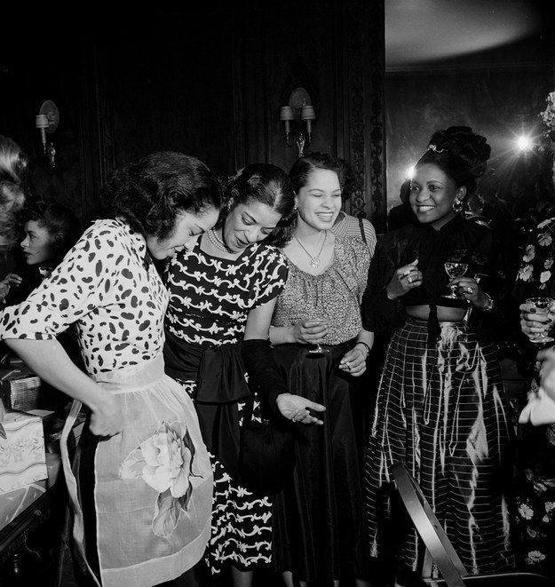 "Maria Cole | 1Cole is pictured in 1948, trying on one of her gifts at a party in Harlem celebrating her marriage to Nat ""King"" Cole."