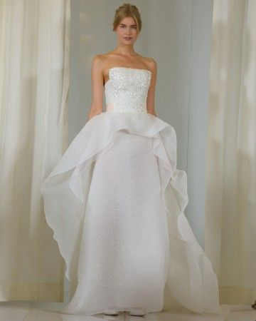 Strapless cloquette gown with cascading ruffle overlay and embroidery on bodice.