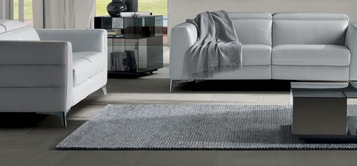 NATUZZI – OTTAVIO  This handmade Italian rug combines wool and viscose to create an alluring texture, ideal for neutral environments thanks to the gray tones that showcase the carpet's the tight weave to pleasing effect.  https://buff.ly/2ycGUQn?utm_content=buffer18bdd&utm_medium=social&utm_source=pinterest.com&utm_campaign=buffer  #ItalianDesignerAccessories #DesignerRug #ItalianCarpet