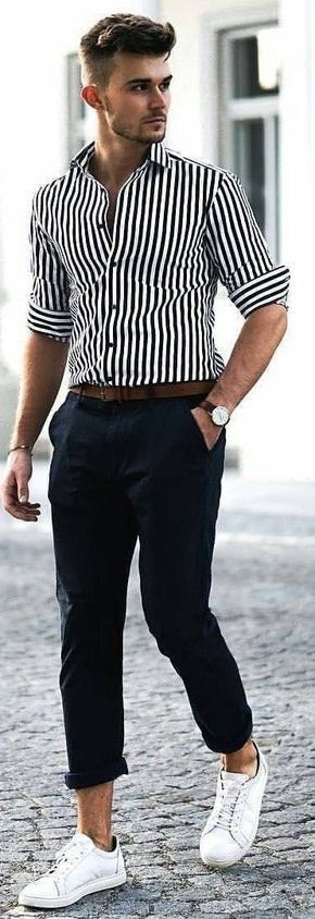 Business casual summer outfit inspiration with a navy and white striped shirt rolled up sleeves brown belt navy trousers (rolled up too high IMHO) brown leather strapped watch no show socks white sneakers #businesscasual #linen #summeroutfits #menswear #mensfashion #menstyle #stripes #mensapparel #whitesneakers