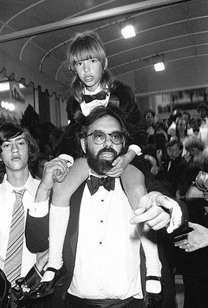 """""""This photo of Sofia sitting on the shoulders of her father Francis Ford was taken at the Cannes film festival in 1979. This very moment was recreated by Wes Anderson in his movie """"The Life Aquatic with Steve Zissou"""" when Steve Zissou is carrying Werner at the end."""""""