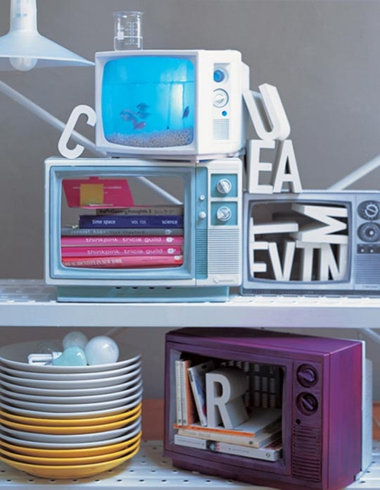 So cute, love the book storage inside old t.v.