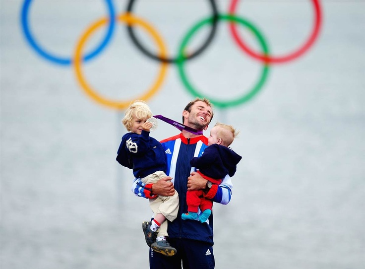 London 2012 Emotional Moments- slideshow Day 11| Silver medalist Nick Dempsey of Great Britain celebrates with his children Thomas-Flynn, left, and Oscar following the men's RS:X sailing.  (Photo: Laurence Griffiths / Getty Images) #NBCOlympics