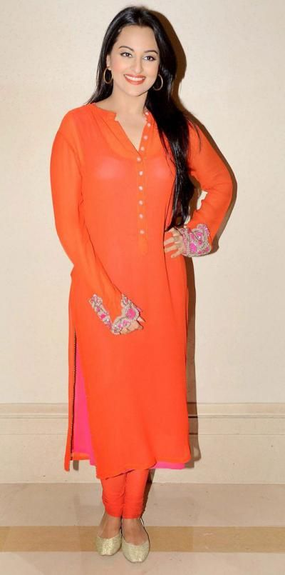 <p>Yet another brilliant look of the lovely actress that all brides would love to copy for any of their post-wedding ceremonies! The plain long bright <em>kurta</em> teamed up with a <em>churidar</em> is surely one of the most comfortable ways to look stylish. The pink and gold embroidery on the hems of the sleeves is just enough to set the festive mood. In the end, simply complete your look just like Sonakshi, by wearing a bright lipstick that matches your outfit.</p>