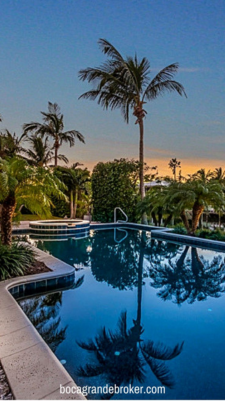 Enjoy an evening swim in the lovely heated Pebble Tec pool and spa of this Boca Grande Island Home. Thoughtful landscaping creates a tropical private oasis. Bring your boat, this property includes 120' on protected deep water complete with a trek dock. #bocagrande #luxury #realestate #islandliving #homes #florida #luxuryhomes #forsale #Realtor