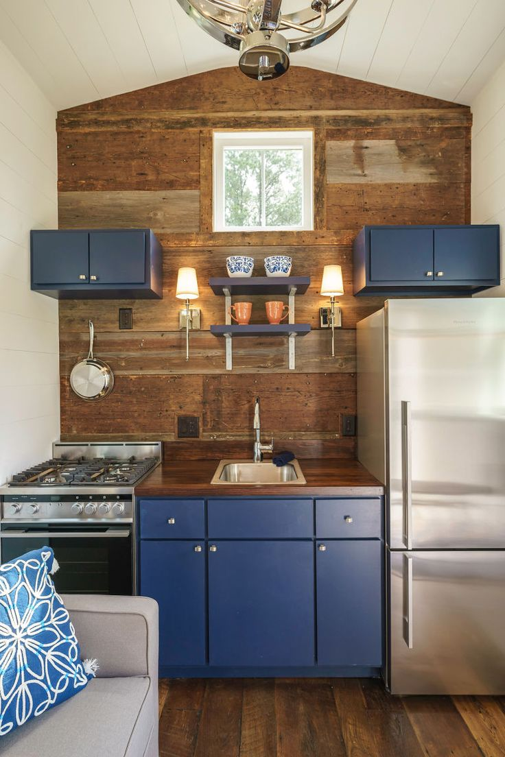 This 280-square-foot house is here to prove anyone who claims you can't use dark colors in a small room wrong. Instead of going light and airy, the Indigo Tiny Home by Driftwood Homes USA is decorated with pops of dark, moody colors. Click through for more design inspiration and paint color ideas from this tiny house.