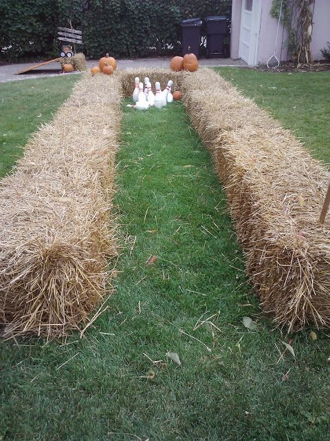 Outdoor bowling with hay bales as bumpers, fun Halloween activity!