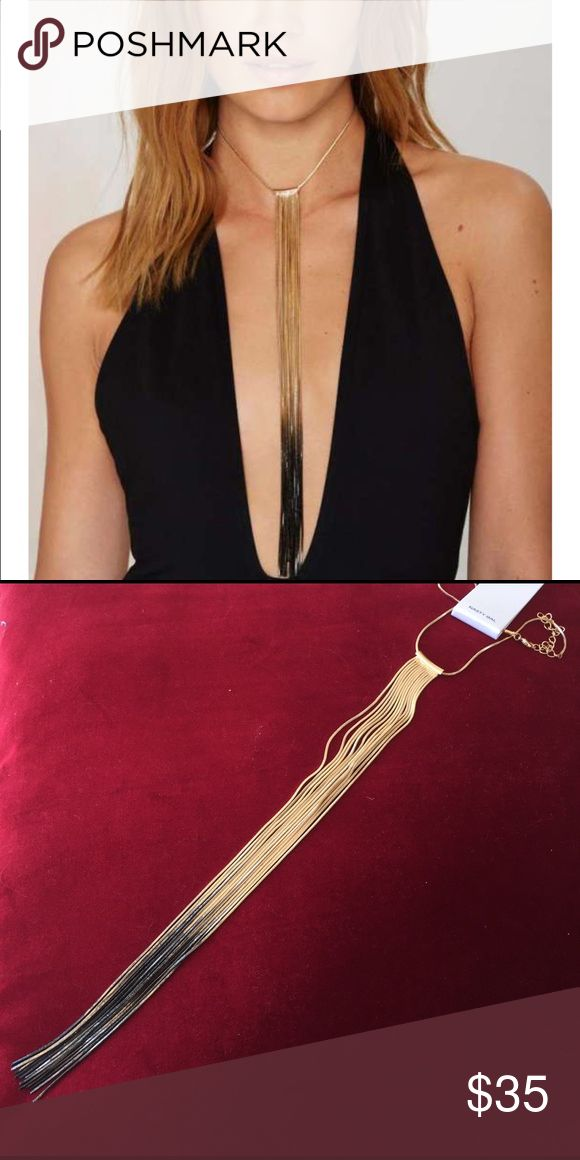 "Fade to Black Gold fringed Necklace by Nasty Gal Gorgeous necklace named ""Fade to Black"". By Nasty Gal this is a gold fringed necklace or choker depending on how tight you clasp it. It fades from gold to black towards the ends. Fringe hangs 21"" from center. Necklace is Aprox. 15"" - 18"" in length. So amazing!!! Nasty Gal Jewelry Necklaces"