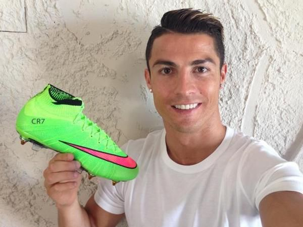 Cristiano Ronaldo holding his Nike Mercurial Superfly boots