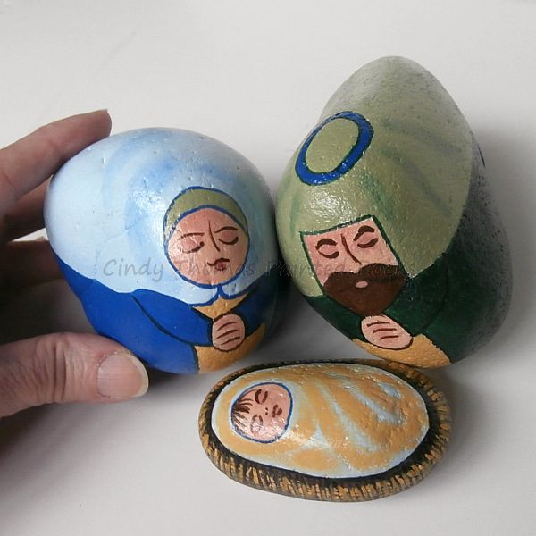 Blue-green nativity set painted on rocks