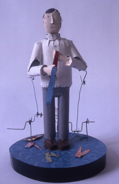 Red Tie/ Blue Tie? 'Red Tie/ Blue Tie' A painted soldered tinplate with a simple wire crank mechanism. Andy Hazell.