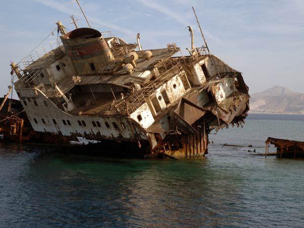 Rusting ship stranded on a coral reef, Island of Tiran,  Sharm El Sheikh, Egypt