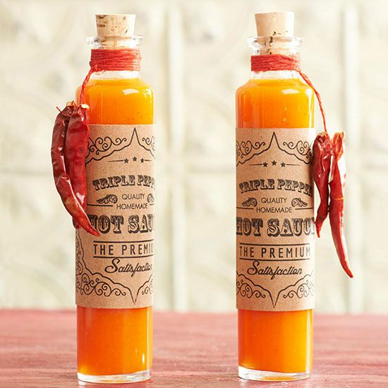 Triple-Pepper Hot Sauce--Three kinds of chile peppers make this hot sauce a perfect food gift for the daredevil in your life. Print our custom labels and tie mild dried chiles onto the bottles.