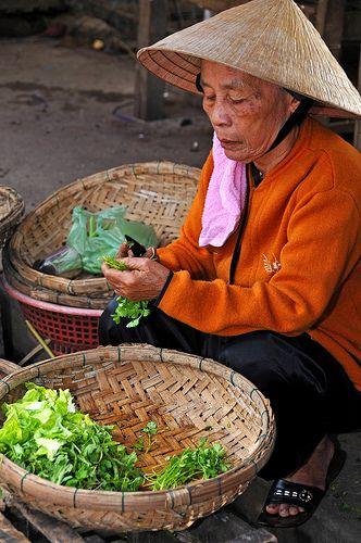 Street Market vendor in Hoi An, Vietnam