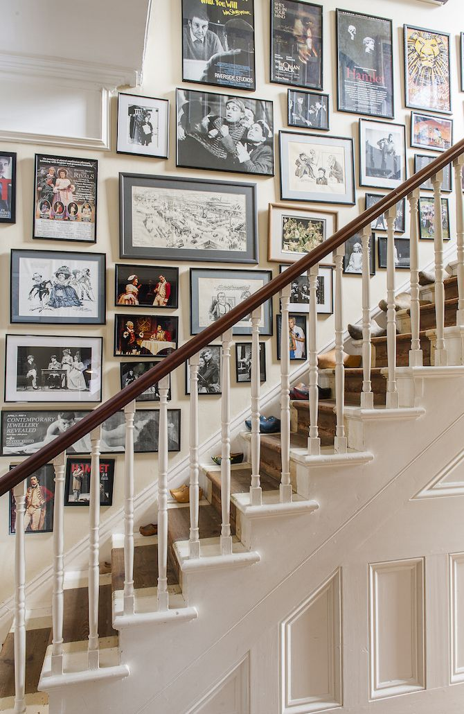 Framed posters and publicity shots line the staircase, showcasing the many roles Catherine's husband has played #WTinteriors