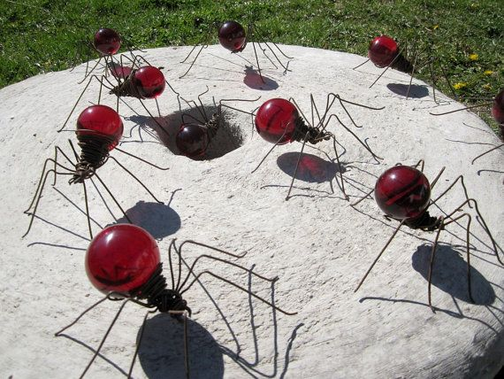 Recycled spiders from rusted wire and light bulbs.