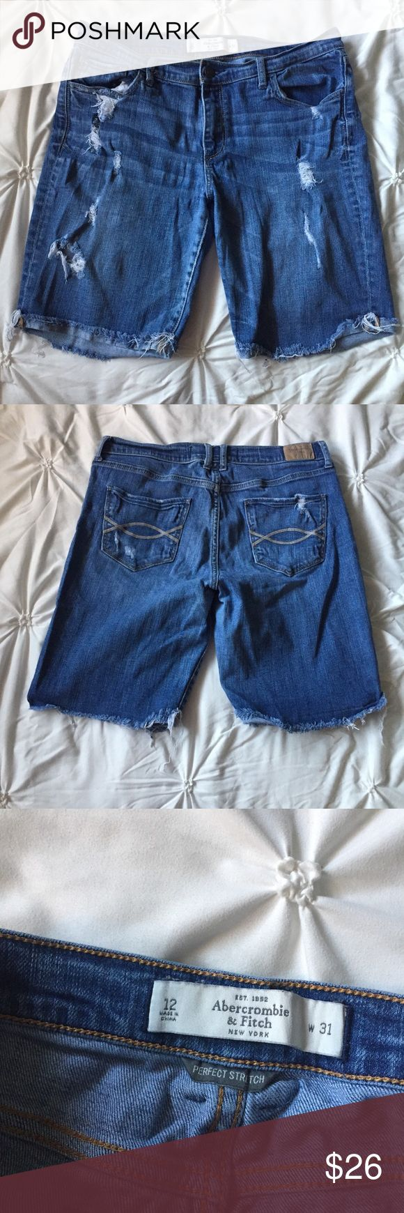 "Abercrombie and Fitch Ripped Jean Bermuda Shorts Abercrombie and Fitch Ripped Blue Jean Denim Bermuda Long Shorts- size 12 / 31 W - 18"" long top to bottom - 9"" inseam - cuffed frayed bottom hem & overall ripped distressed look, great condition!  ----- 🚭 All items are from a non-smoking home. 👆🏻Item is as described, feel free to ask questions. 📦 I am a fast shipper with excellent ratings. 👗I love bundles & bundle discounts. Feel free to make an offer! 😍 Like this item? Check out the…"
