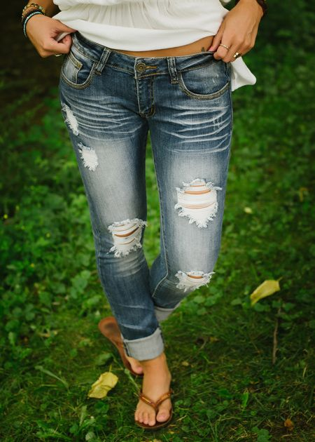 """Low rise skinny jeans with distressing.  Traditional 5 pocket and zipper closure with a 31"""" inseam."""