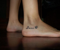 Maybe just the small paw print to represent my love for dogs. If I tattooed all of the dogs' names on my body that I have ever and will ever love, I would be covered. I ♥ dogs :)
