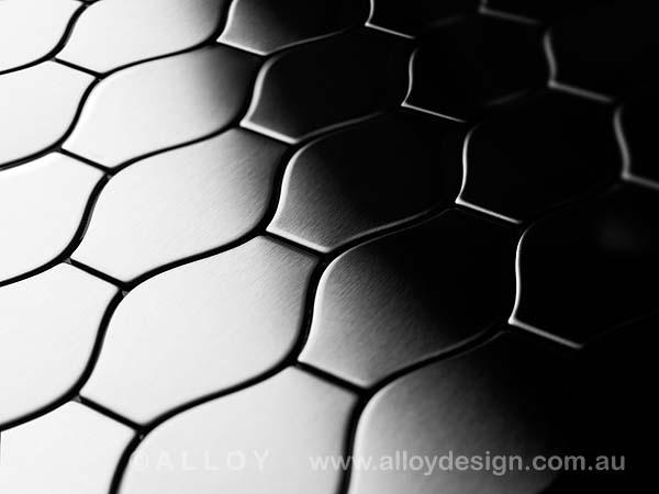 Karim Rashid for ALLOY 'Karma' tile in brushed stainless steel.